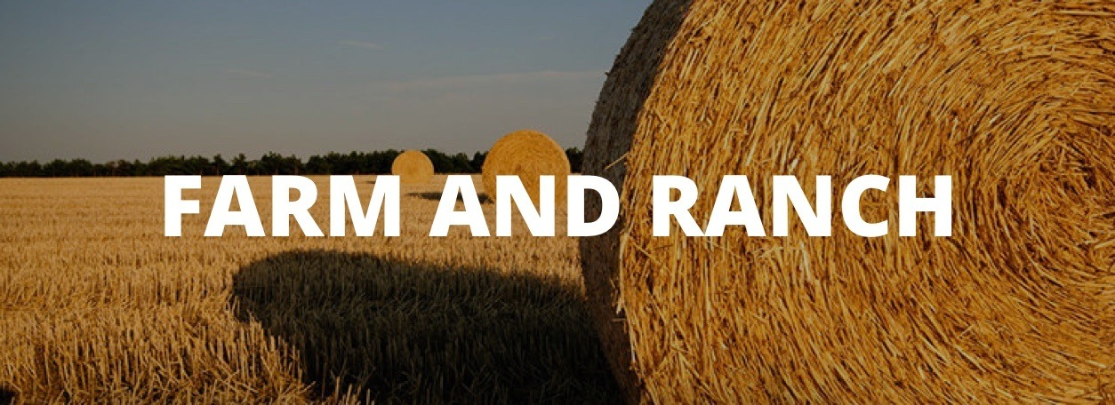 Farm and Ranch text with the hay in field